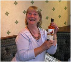 A winner! Elizabeth scoops one of the raffle prizes