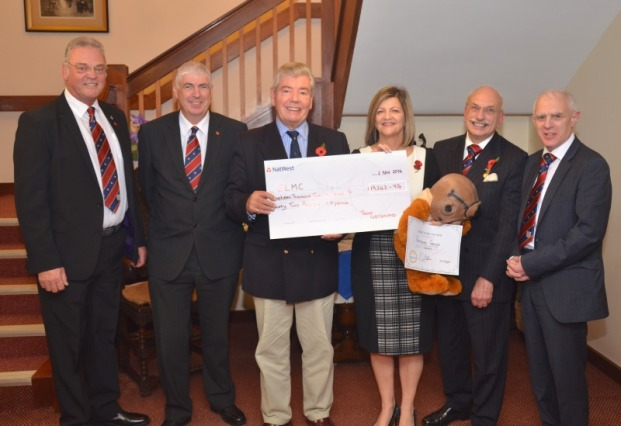 Provincial Grand Master Sir David Trippier presents a cheque to E.L.M.C.